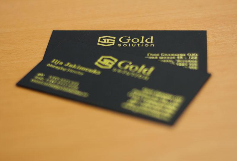 Gold hotfoil cards on black board